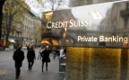 The logo of Swiss bank Credit Suisse is seen in front of a branch office in Zurich November 21, 2013. Credit Suisse has set out plans to separate its domestic operations from its more risky investment banking business, as part of post credit-crunch efforts to insulate Swiss taxpayers from costly bank bailouts. REUTERS/Arnd Wiegmann (SWITZERLAND - Tags: BUSINESS LOGO) - RTX15N9I